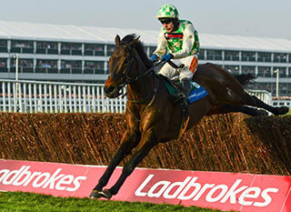 Ballynagour, with Tom Scudamore up, jumping over a fence during Cheltenham Festival Plate