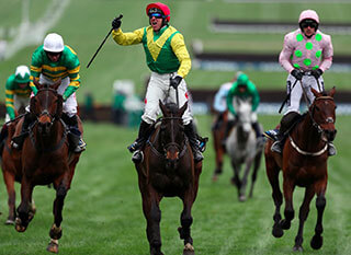 Confident jockey leading the race at Cheltenham