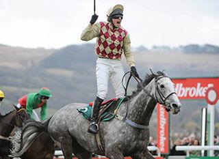 Jockey Jamie Codd celebrates winning last year's Fulke Walwyn Kim Muir Challenge Cup Hand