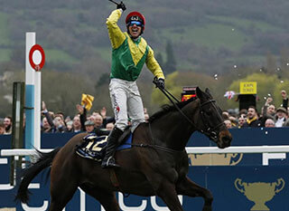 Jockey celebrating after the Johnny Henderson Grand Annual Handicap Chase