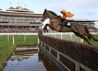 Perfect capture of a race jumping over the fence at the RSA Steeple Chase