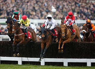 Tom Scudamore rides Un Temps Pour Tout during the Ultima Handicap Chase at the Cheltenham Festival